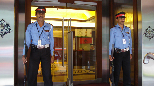Armed Guards / Gun Men Guarding Jewellery Showroom